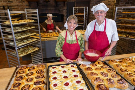 Massive cinnamon rolls from the bakery are among Silver Dollar City's holiday treats during An Old Time Christmas.