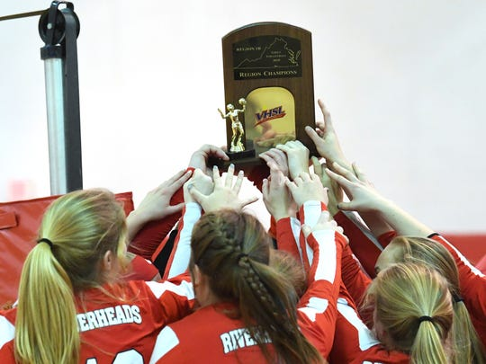 Riverheads players hoist high the championship trophy after winning the Region 1B volleyball championship in Greenville on Wednesday, Nov. 7, 2018.