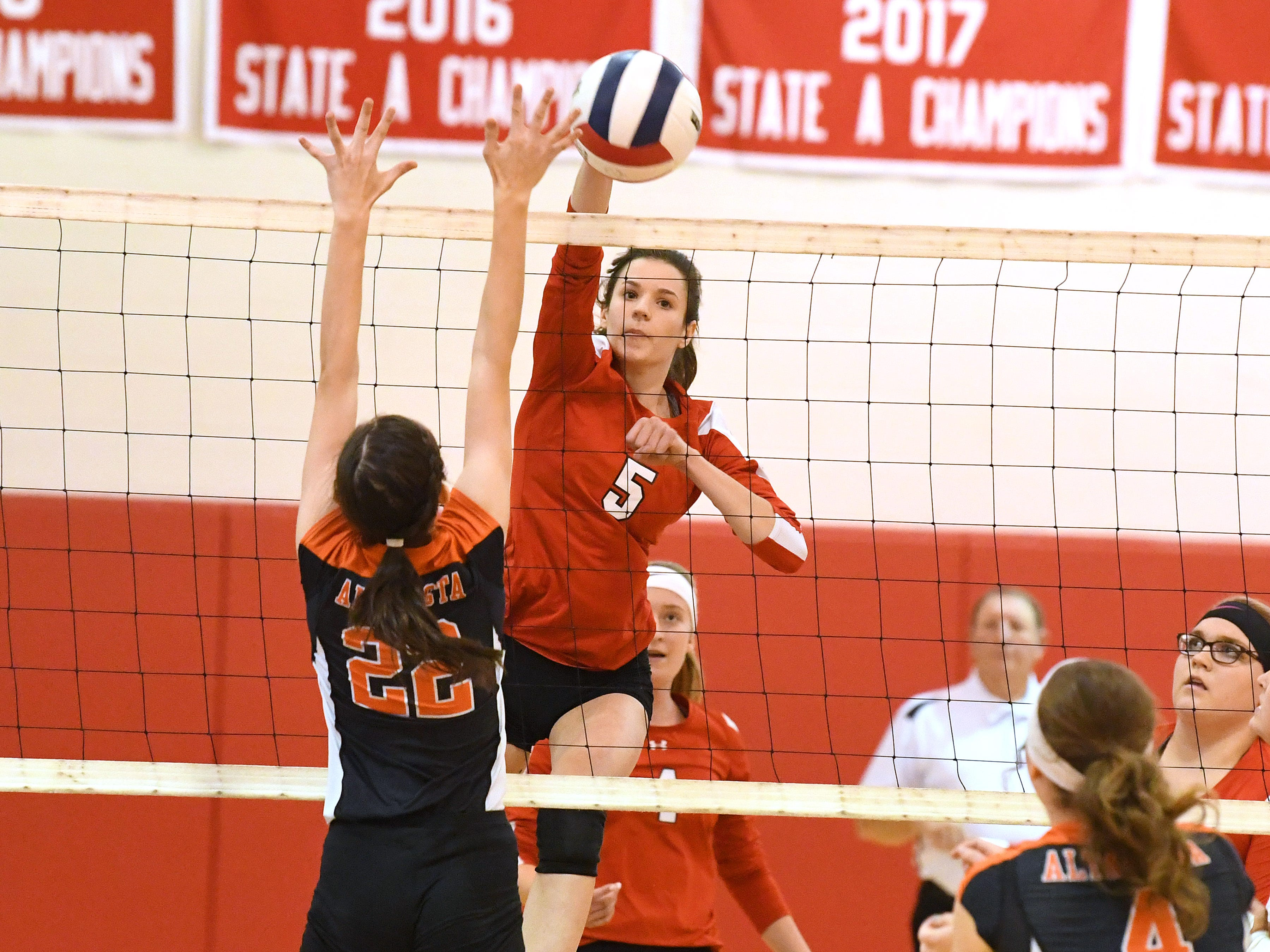Riverheads' Abbey Eavers spikes the ball past Altavista's Lillian Castro during the Region 1B volleyball championship played in Greenville on Wednesday, Nov. 7, 2018.