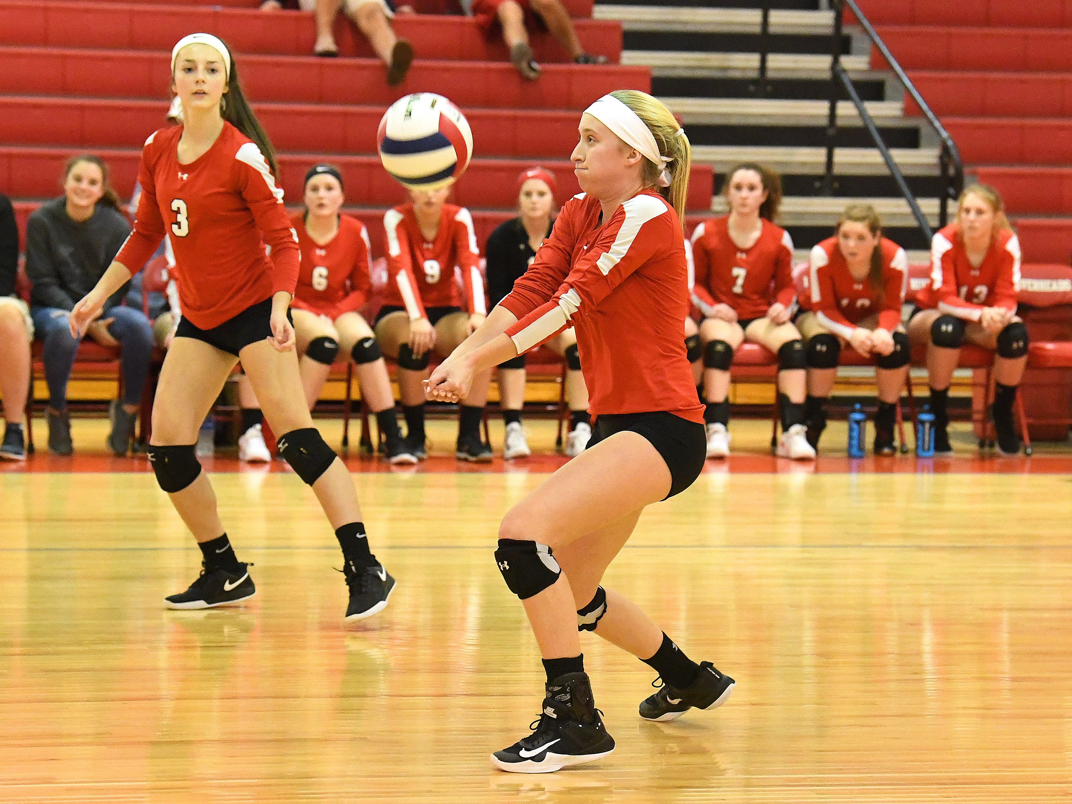 Riverheads' Emma Tomlinson bumps the ball as teammate Kendyl Argenbright watches during the Region 1B volleyball championship played in Greenville on Wednesday, Nov. 7, 2018.
