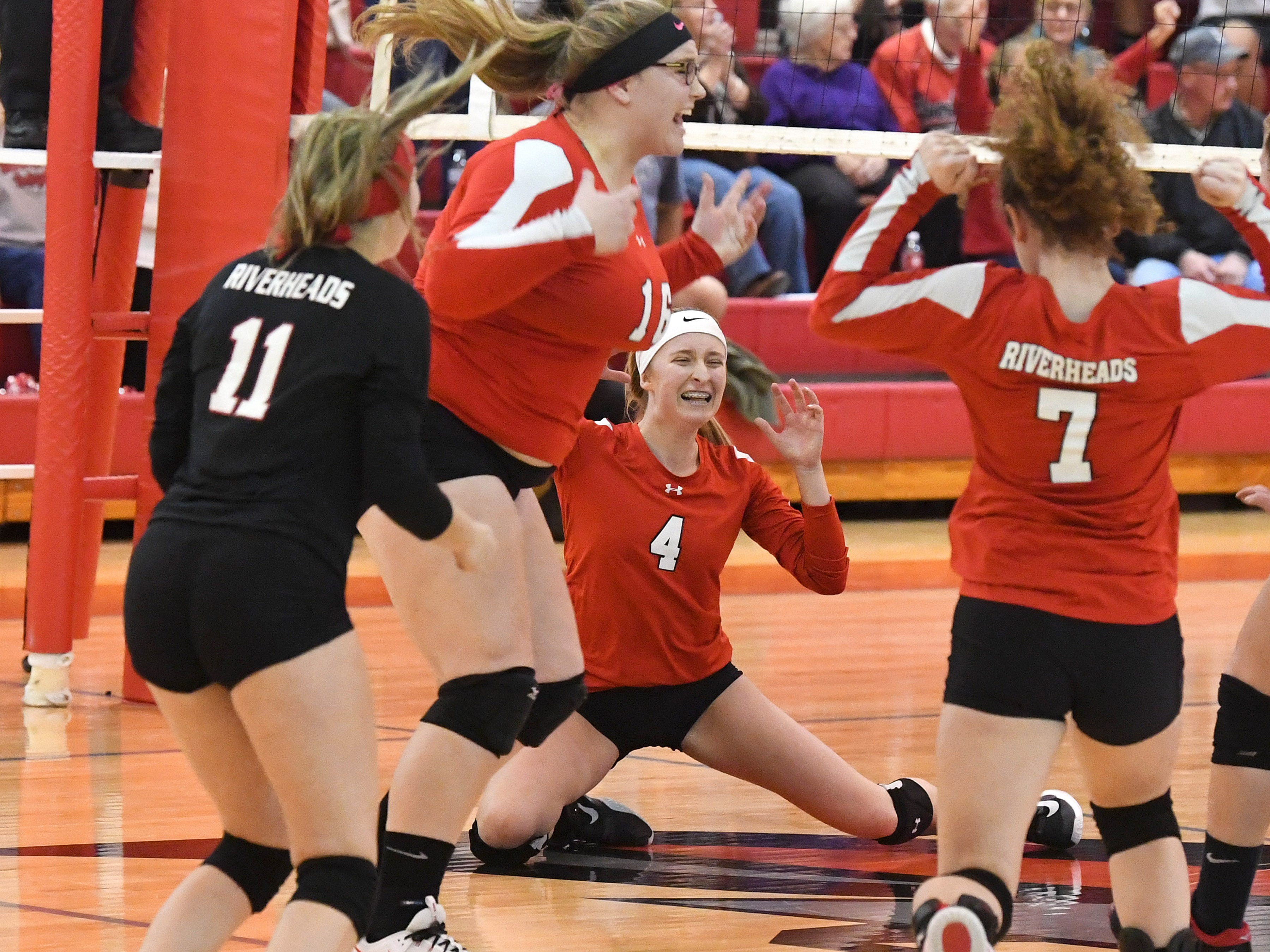 Riverheads players celebrate scoring the final point in the third set to sweep Altavista and win the Region 1B volleyball championship in Greenville on Wednesday, Nov. 7, 2018.
