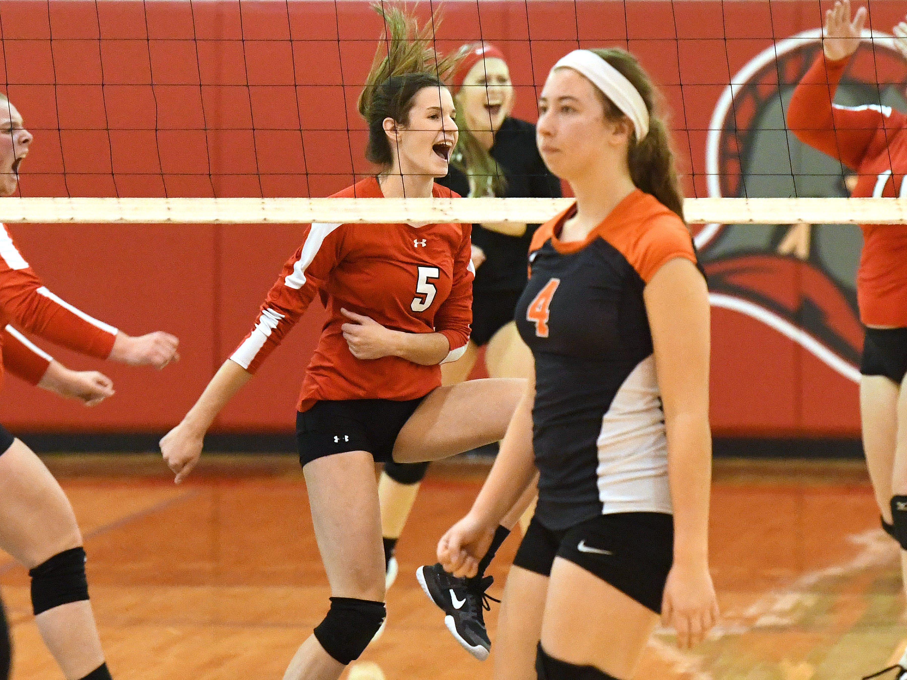 Riverheads' Abbey Eavers celebrates scoring a point during the Region 1B volleyball championship played in Greenville on Wednesday, Nov. 7, 2018.