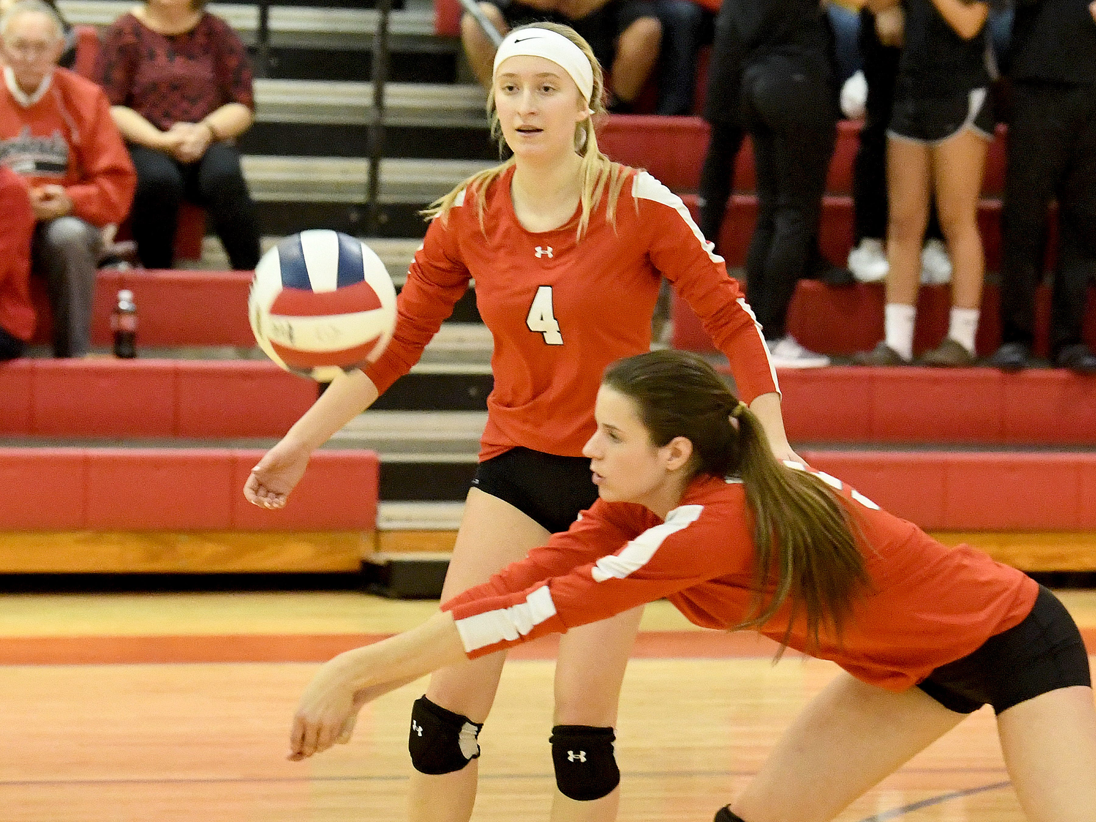 Riverheads' Emma Tomlinson watches as teammate Abbey Eavers bumps the ball during the Region 1B volleyball championship played in Greenville on Wednesday, Nov. 7, 2018.