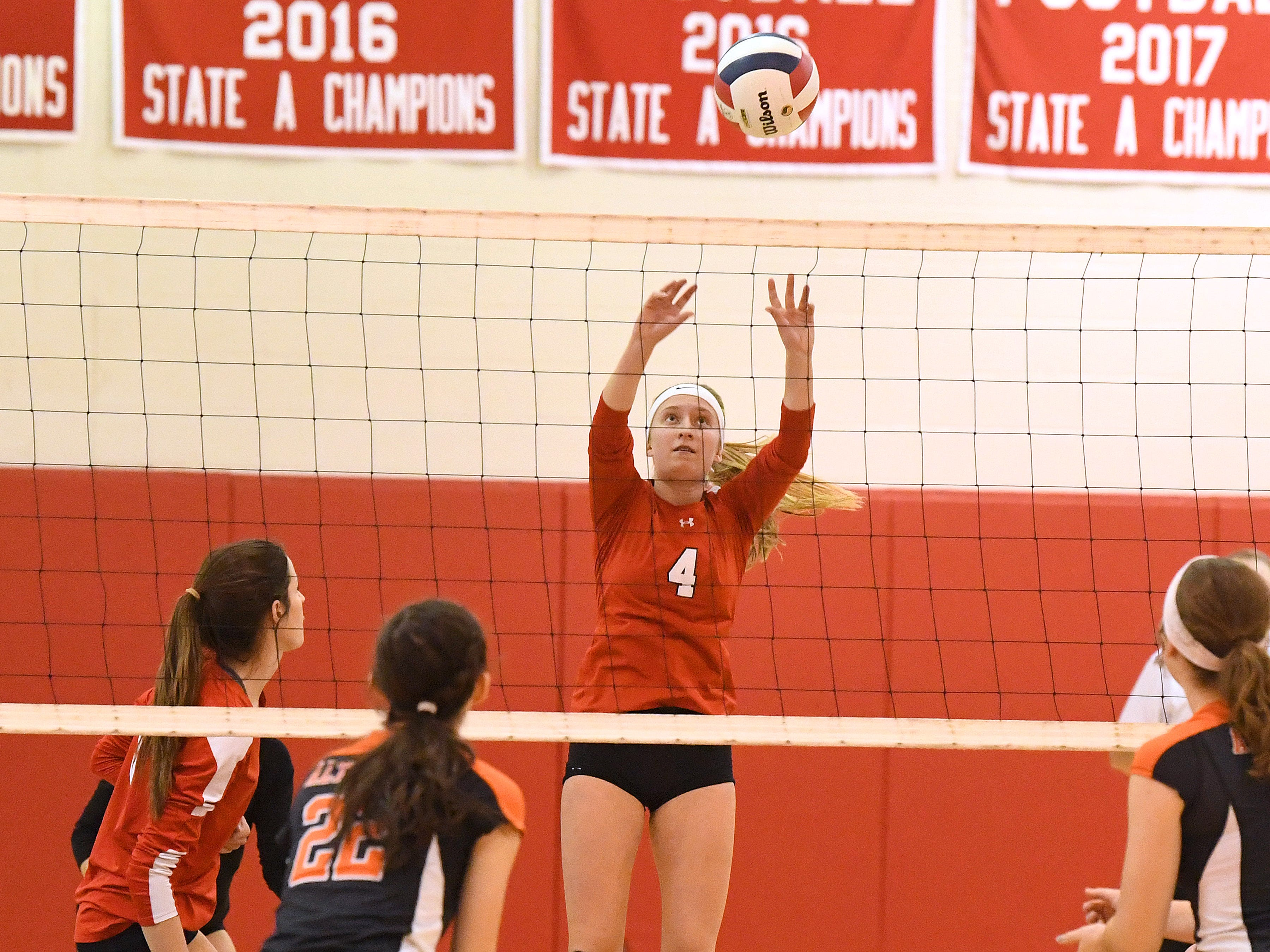 Riverheads' Emma Tomlinson sends the ball back across the net during the Region 1B volleyball championship played in Greenville on Wednesday, Nov. 7, 2018.