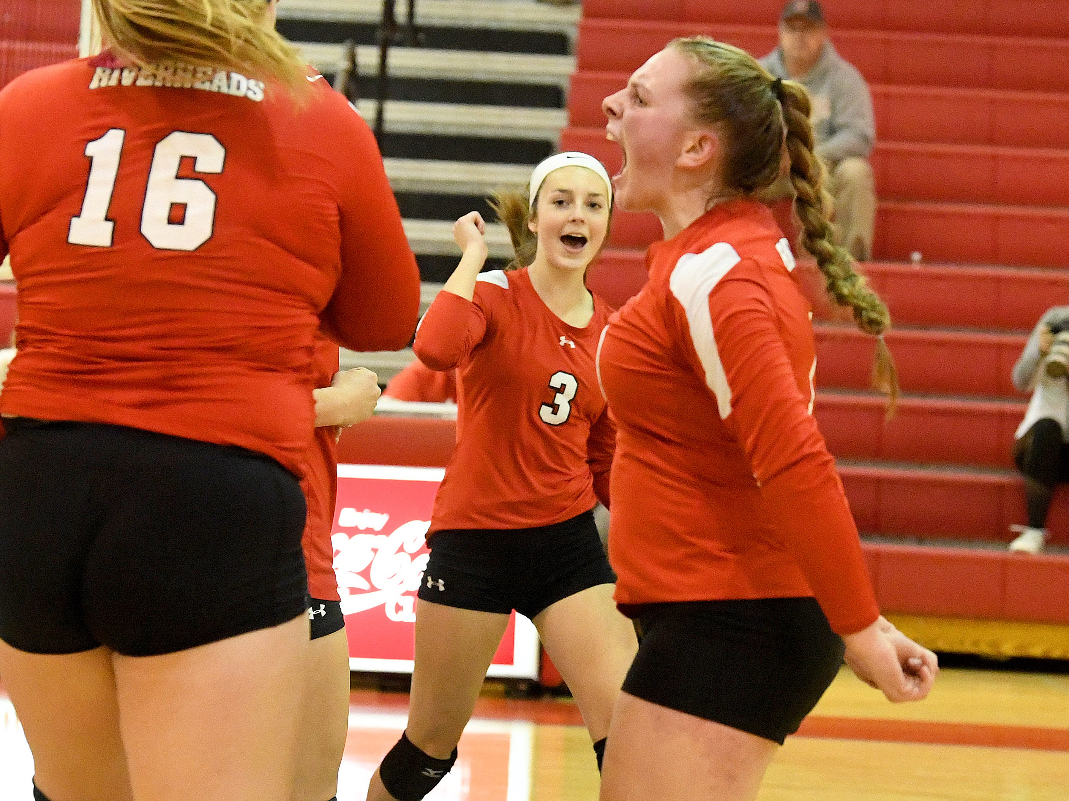 Riverheads' Kendyl Argenbright celebrates a point scored on court with her teammates during the Region 1B volleyball championship played in Greenville on Wednesday, Nov. 7, 2018.