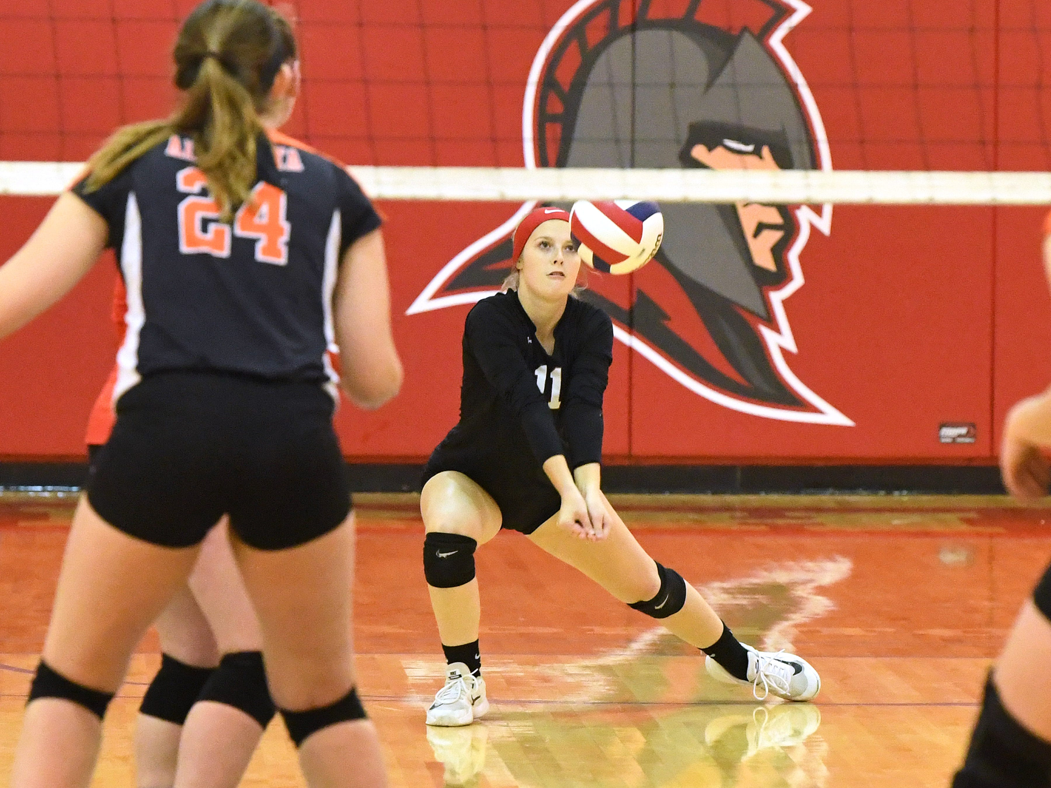 Riverheads' Samantha Persinger bumps the ball during the Region 1B volleyball championship played in Greenville on Wednesday, Nov. 7, 2018.