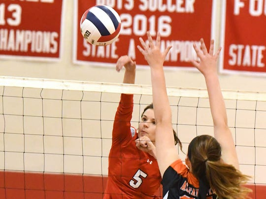 Riverheads' Abbey Eavers spikes the ball during the Region 1B volleyball championship played in Greenville on Wednesday, Nov. 7, 2018.