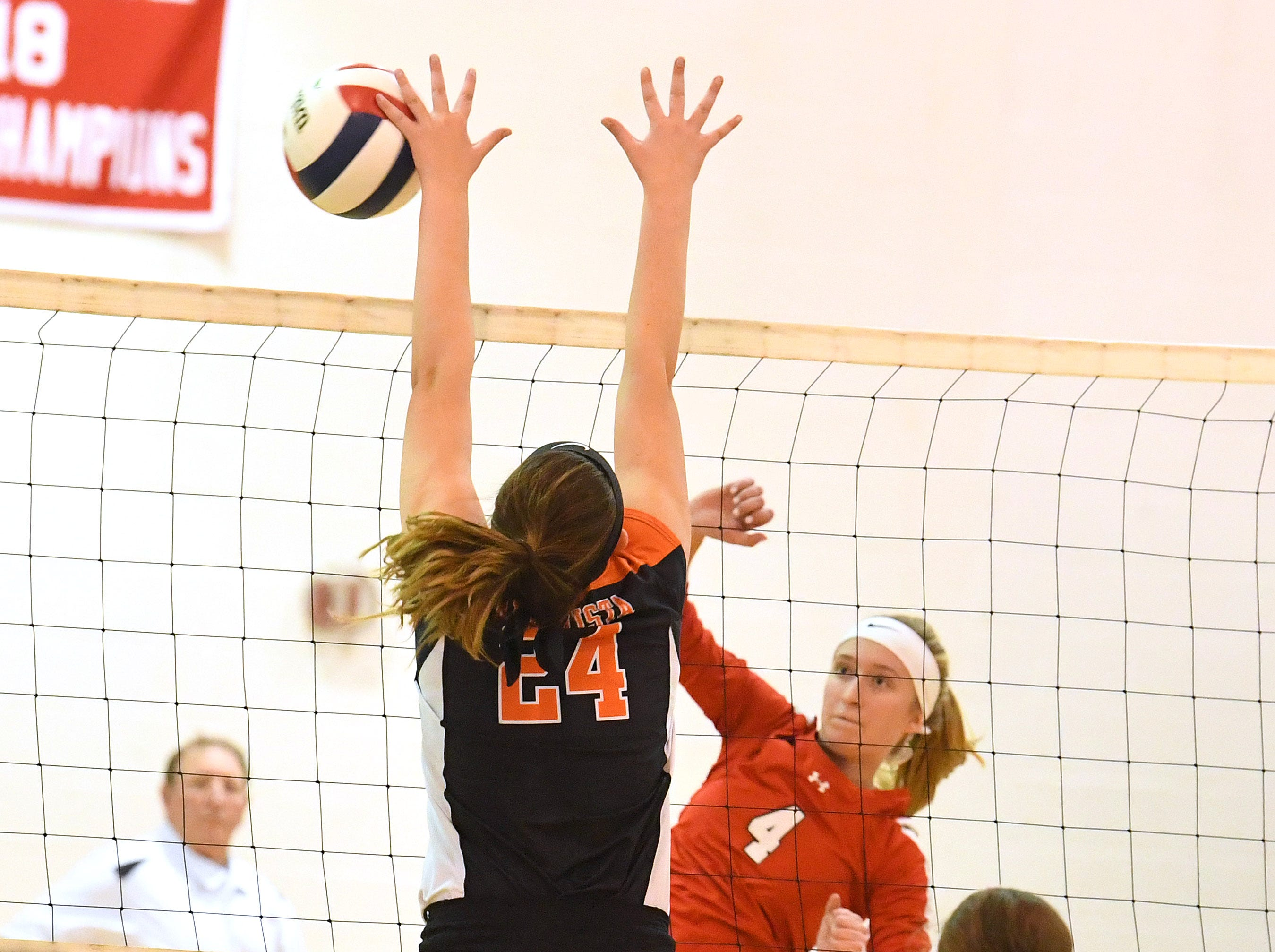 Rivrheads Emma Tomlinson sends the ball across the net past Altavista's Rachel Branning during the Region 1B volleyball championship played in Greenville on Wednesday, Nov. 7, 2018.