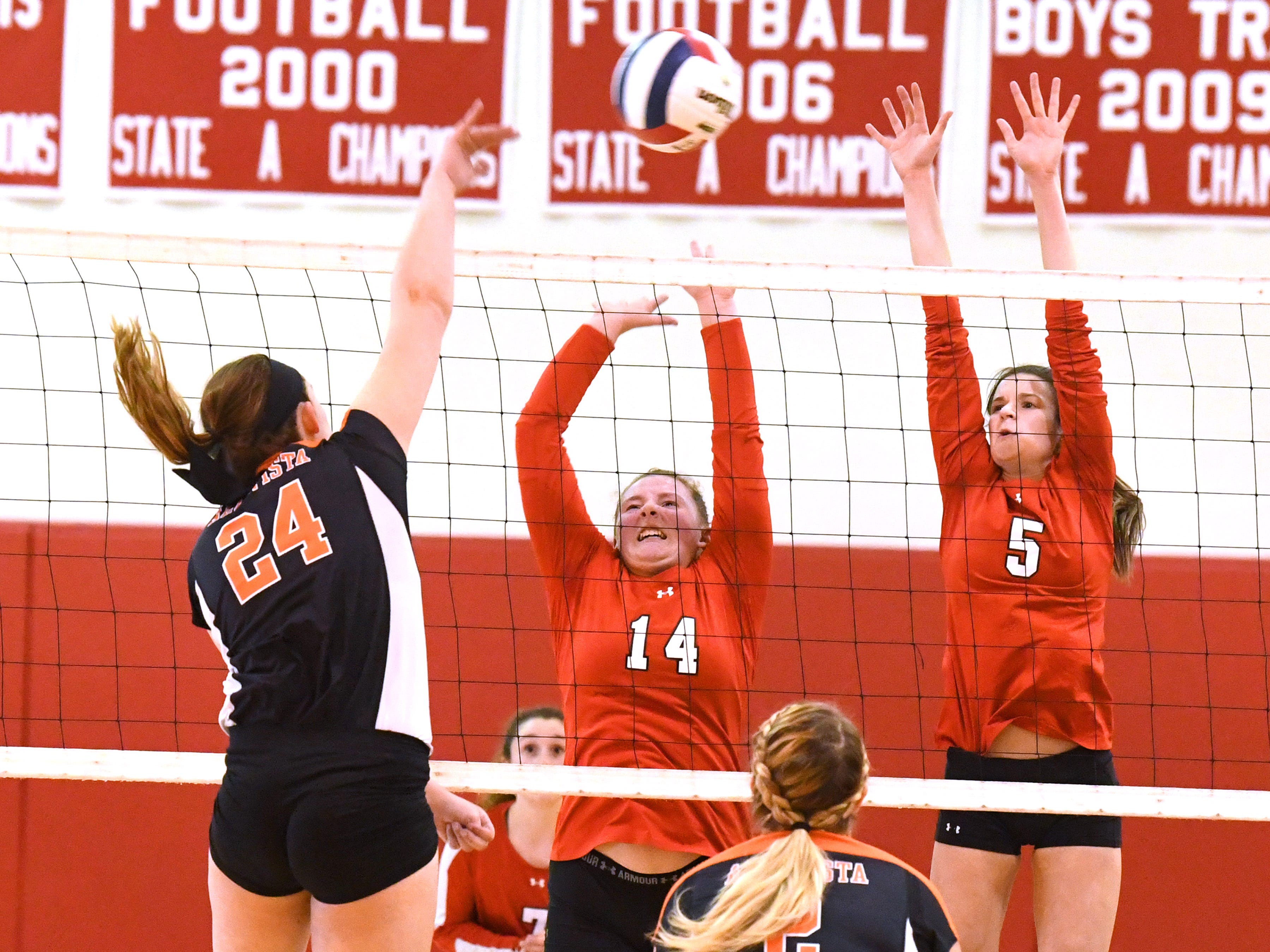 Riverheads' Dayton Moore and Abbey Eavers tries to block a hit by Altavista's Rachel Branning at the net during the Region 1B volleyball championship played in Greenville on Wednesday, Nov. 7, 2018.