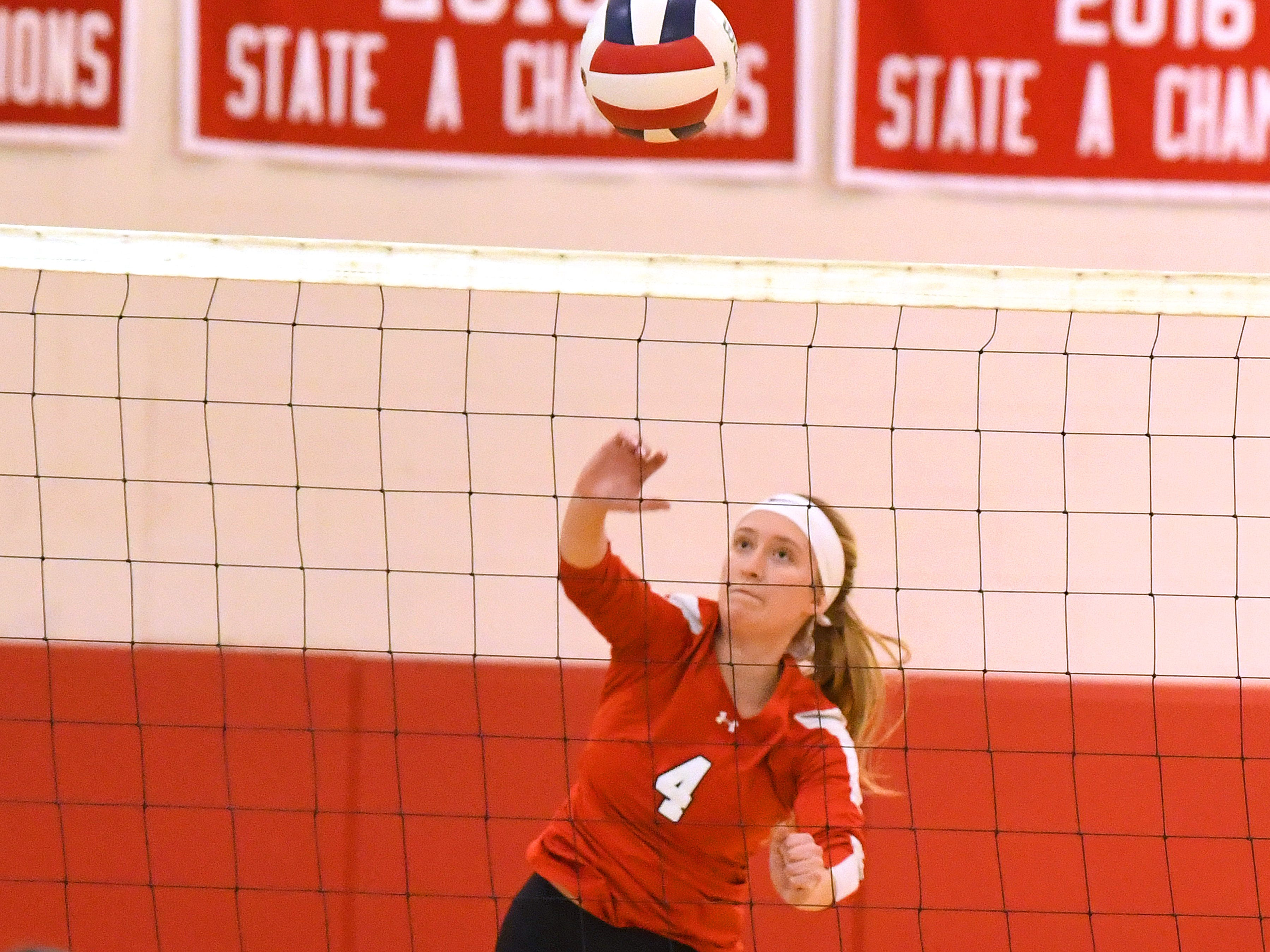 Riverheads' Emma Tomlinson spikes the ball during the Region 1B volleyball championship played in Greenville on Wednesday, Nov. 7, 2018.