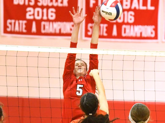 Riverheads' Abbey Eavers blocks at the net during the Region 1B volleyball championship played in Greenville on Wednesday, Nov. 7, 2018.