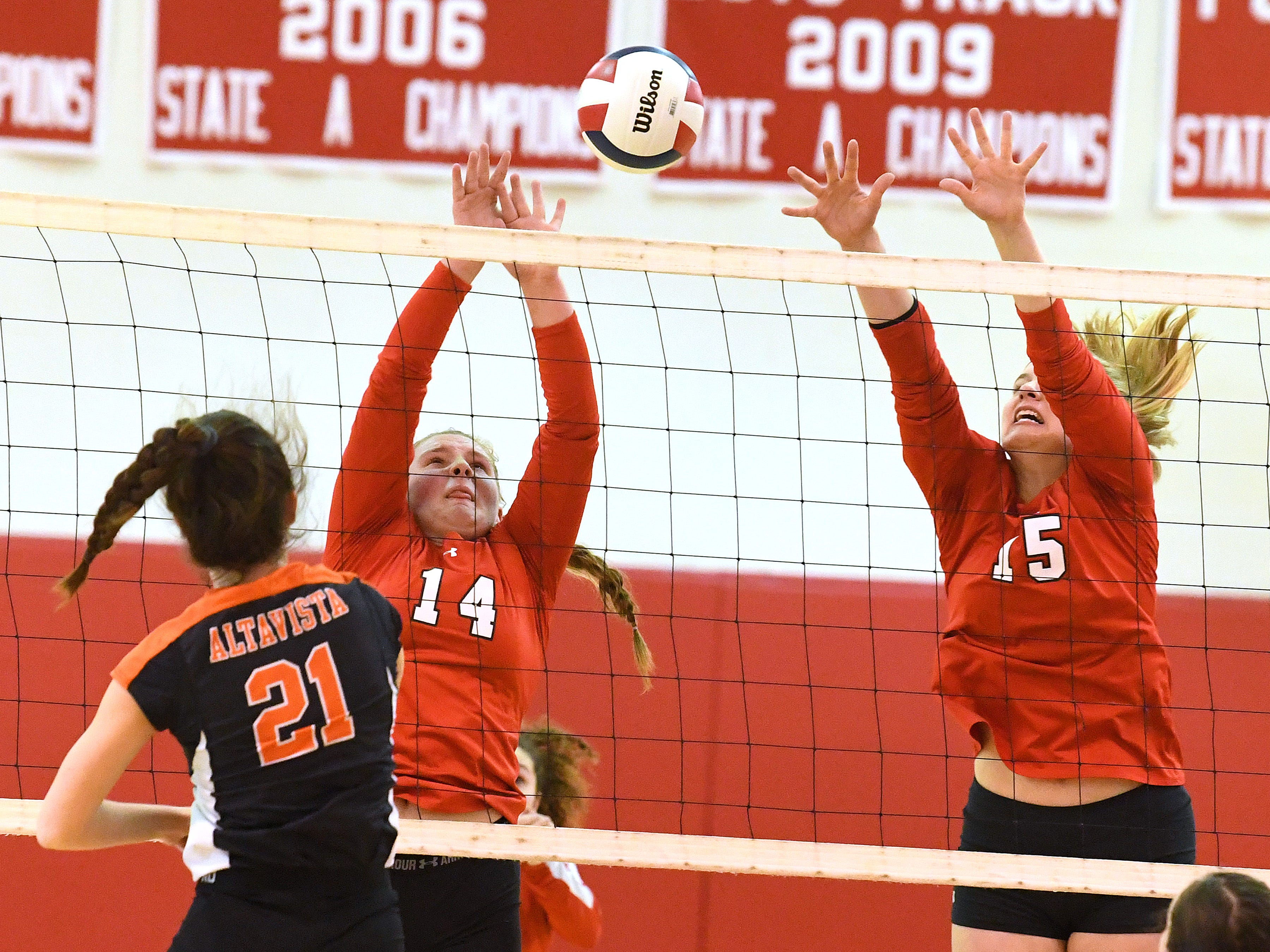 Riverheads' Dayton Moore and Eva Frederick block a return by Altavista's Madeline Tweedy at the net during the Region 1B volleyball championship played in Greenville on Wednesday, Nov. 7, 2018.