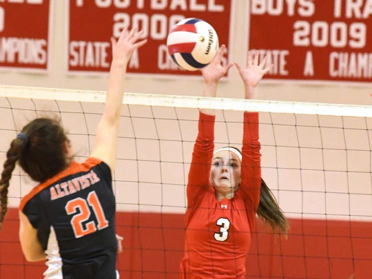 Riverheads' Kendyl Argenbright tries to block a hit by Altavista's Madeline Tweedy at the net during the Region 1B volleyball championship played in Greenville on Wednesday, Nov. 7, 2018.