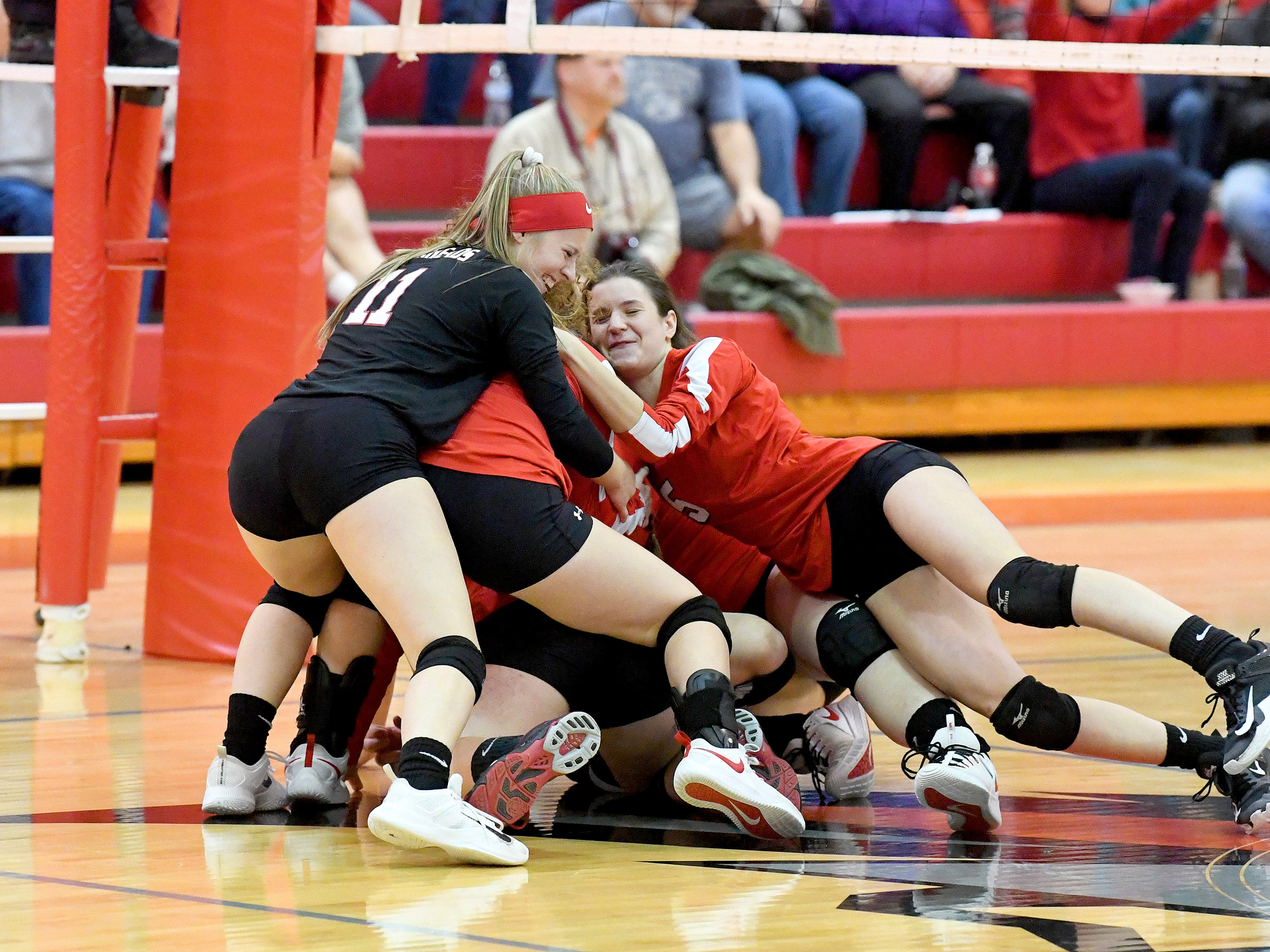Riverheads players celebrate with a dogpile on the court after scoring the final point in the third set to sweep Altavista and win the Region 1B volleyball championship in Greenville on Wednesday, Nov. 7, 2018.