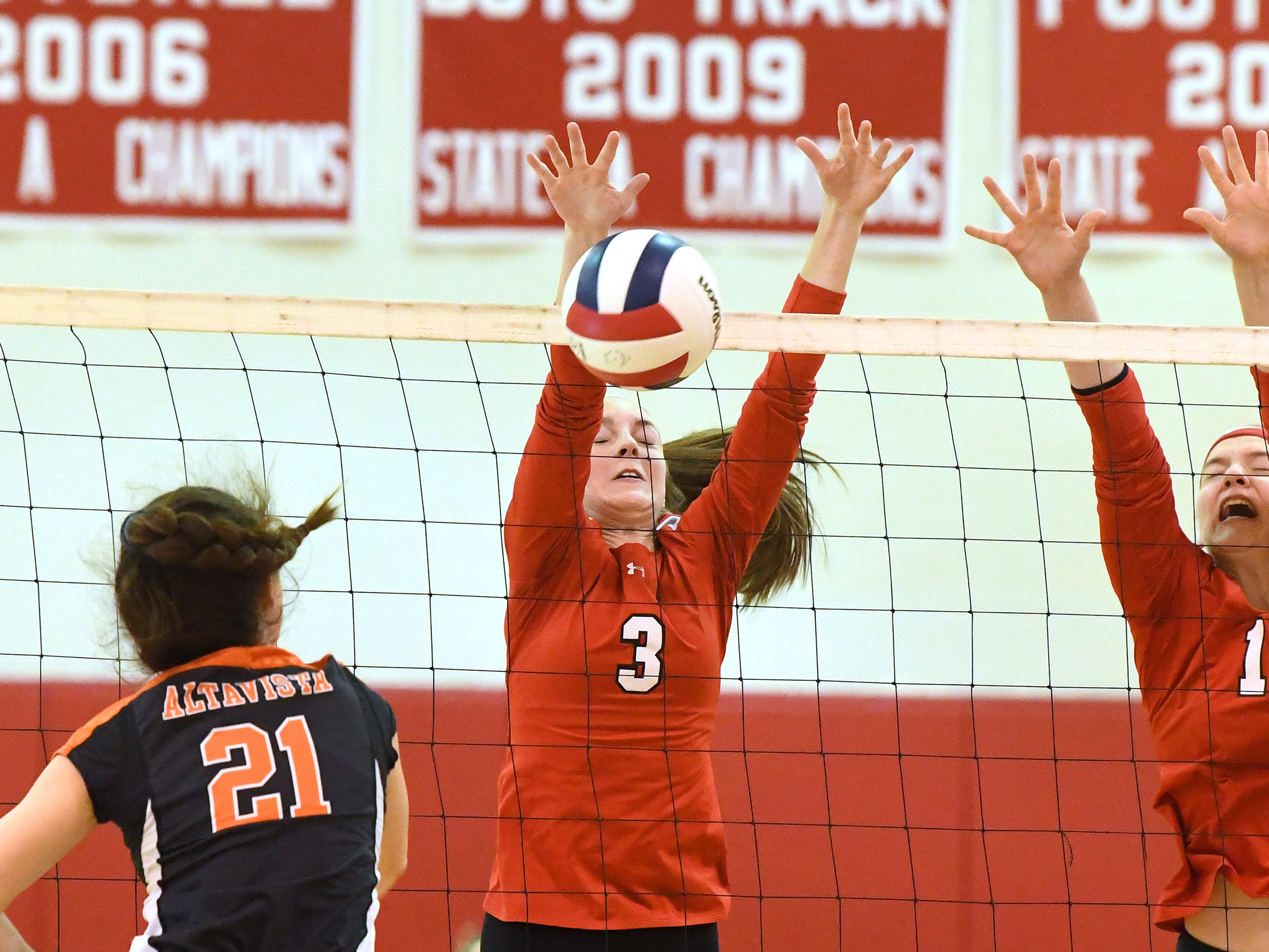 Riverheads' Kendryl Argenbright blocks an Altavista return at the net during the Region 1B volleyball championship played in Greenville on Wednesday, Nov. 7, 2018.