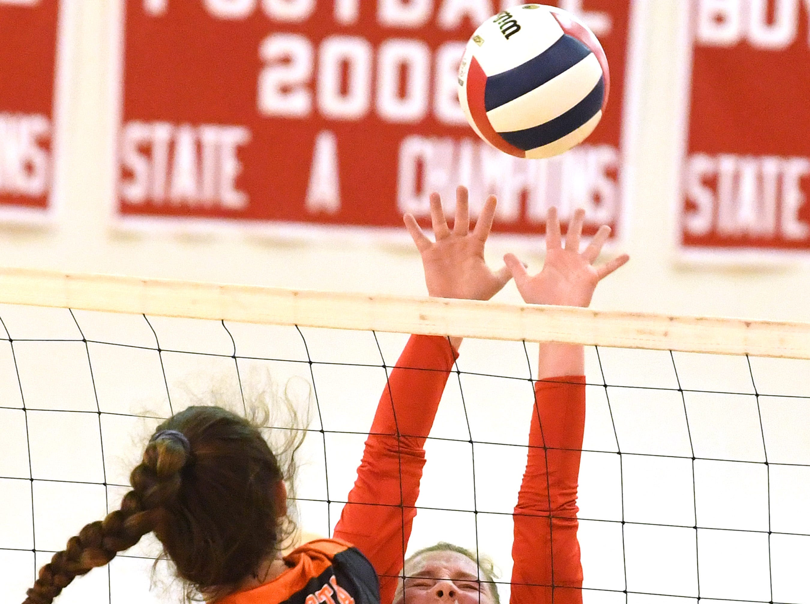 Riverheads' Dayton Moore reaches to try to block a hit by Altavista's Madeline Tweedy at the net during the Region 1B volleyball championship played in Greenville on Wednesday, Nov. 7, 2018.