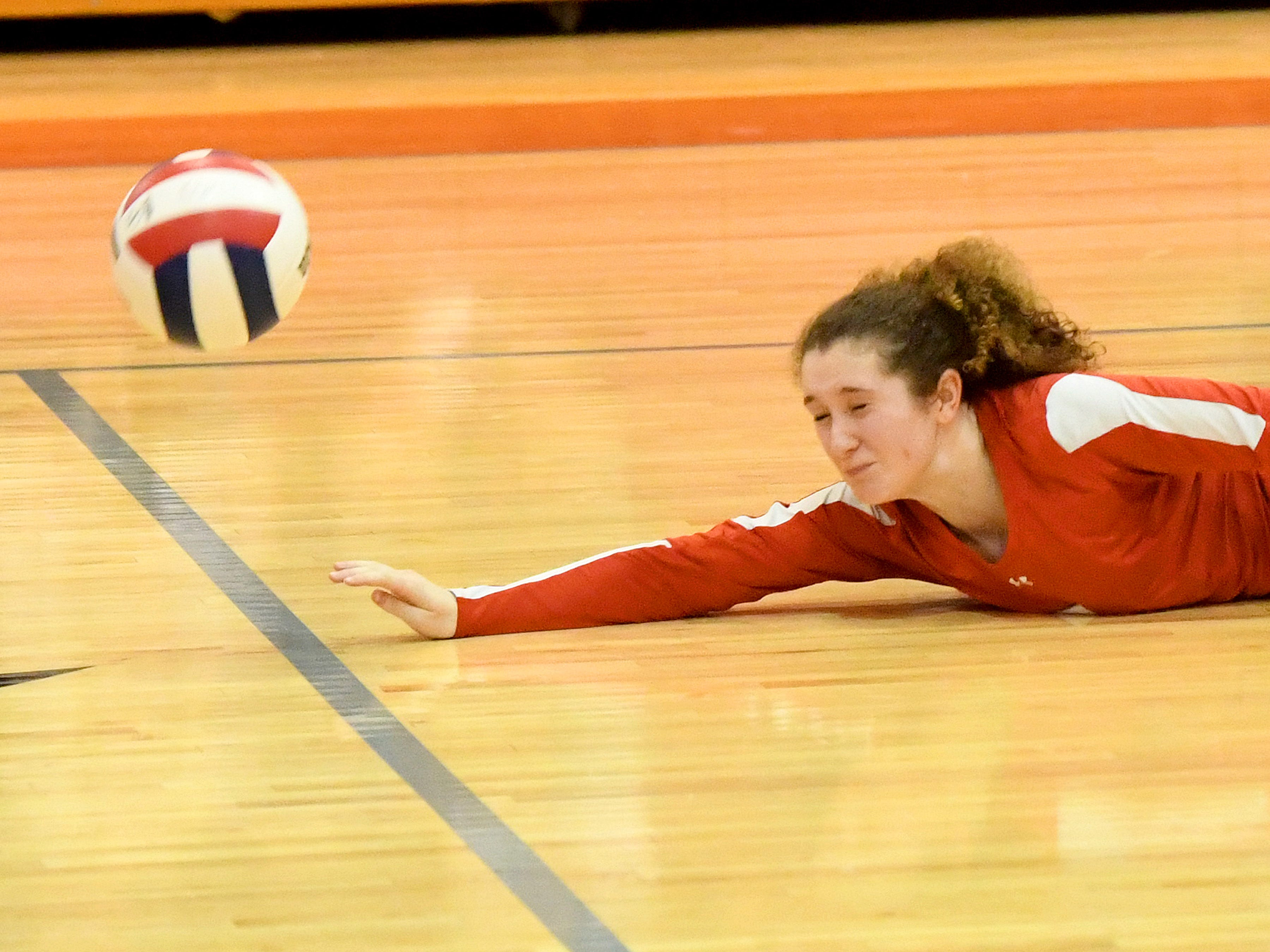 Riverheads' Gracie Fulton goes down trying to keep the ball in play during the Region 1B volleyball championship played in Greenville on Wednesday, Nov. 7, 2018.