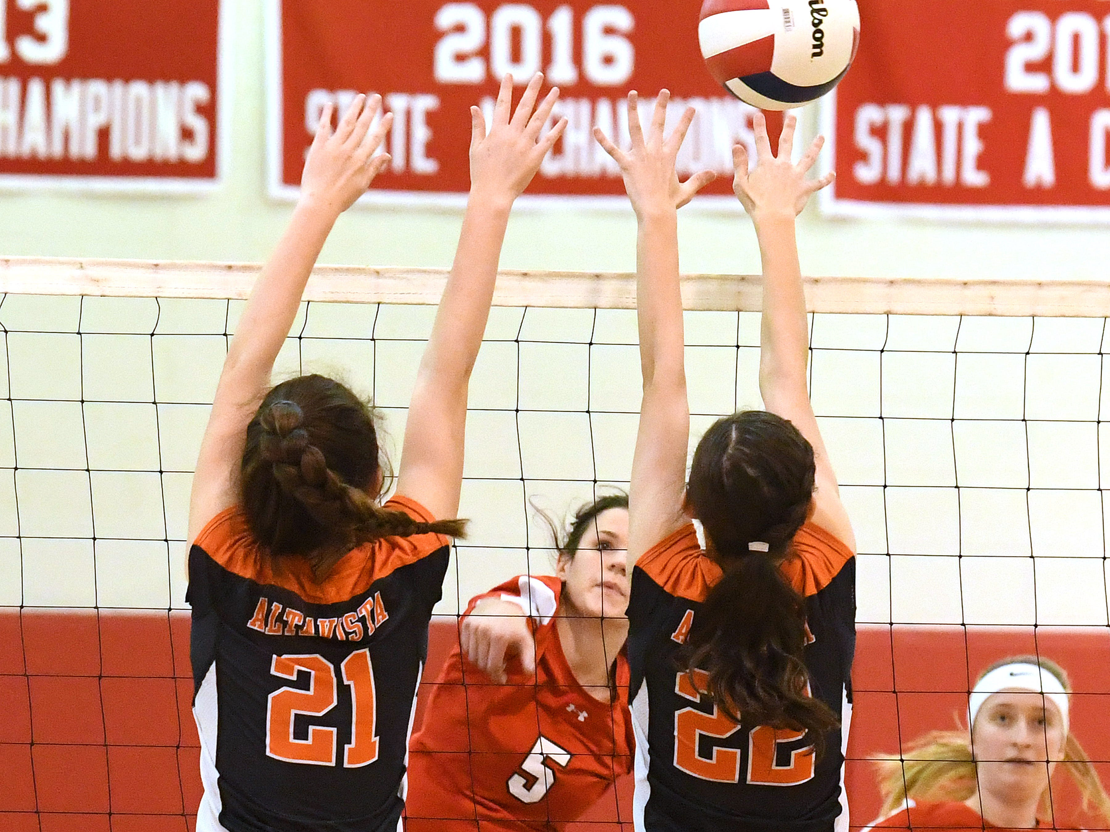 Riverheads' Abbey Eavers hits the ball past Altavista's Madeline Tweedy and Lillian Castro during the Region 1B volleyball championship played in Greenville on Wednesday, Nov. 7, 2018.