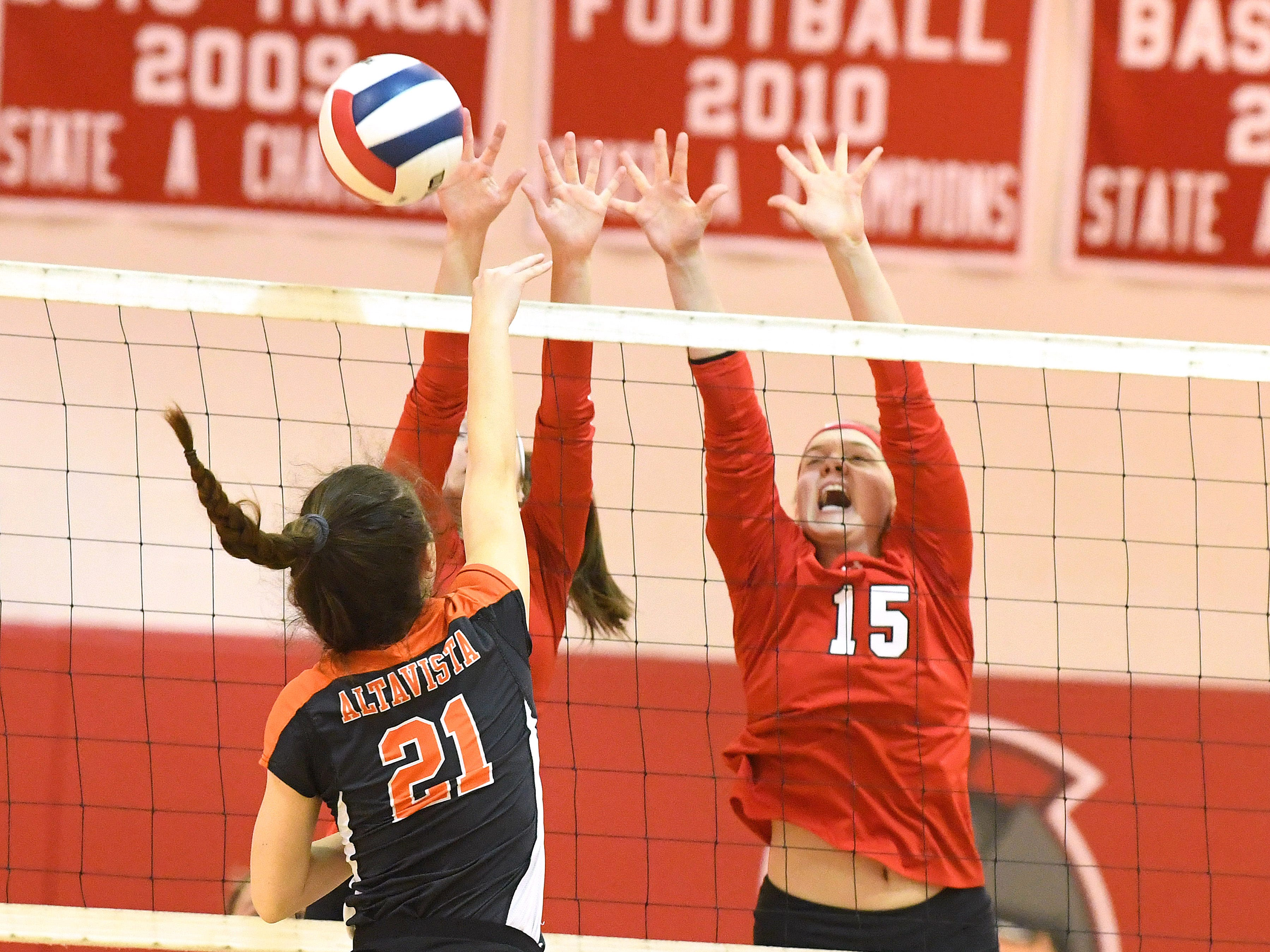 Riverheads' Eva Frederick tries to block a hit by Altavista's Madeline Tweedy at the net during the Region 1B volleyball championship played in Greenville on Wednesday, Nov. 7, 2018.