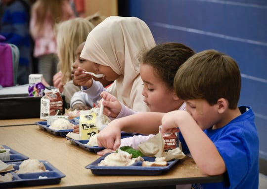 Students eat lunch Nov. 8, 2018 at Oak Hill Elementary School in St. Cloud.
