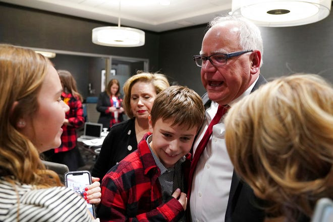 Democratic-Farmer-Labor gubernatorial candidate Tim Walz hugs his family after it was projected he'd win, at the Intercontinental Hotel in downtown St. Paul, Minn., Tuesday, Nov. 6.