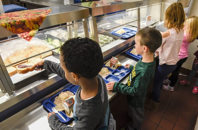 Students get their lunch at Oak Hill Community School in this file photo.