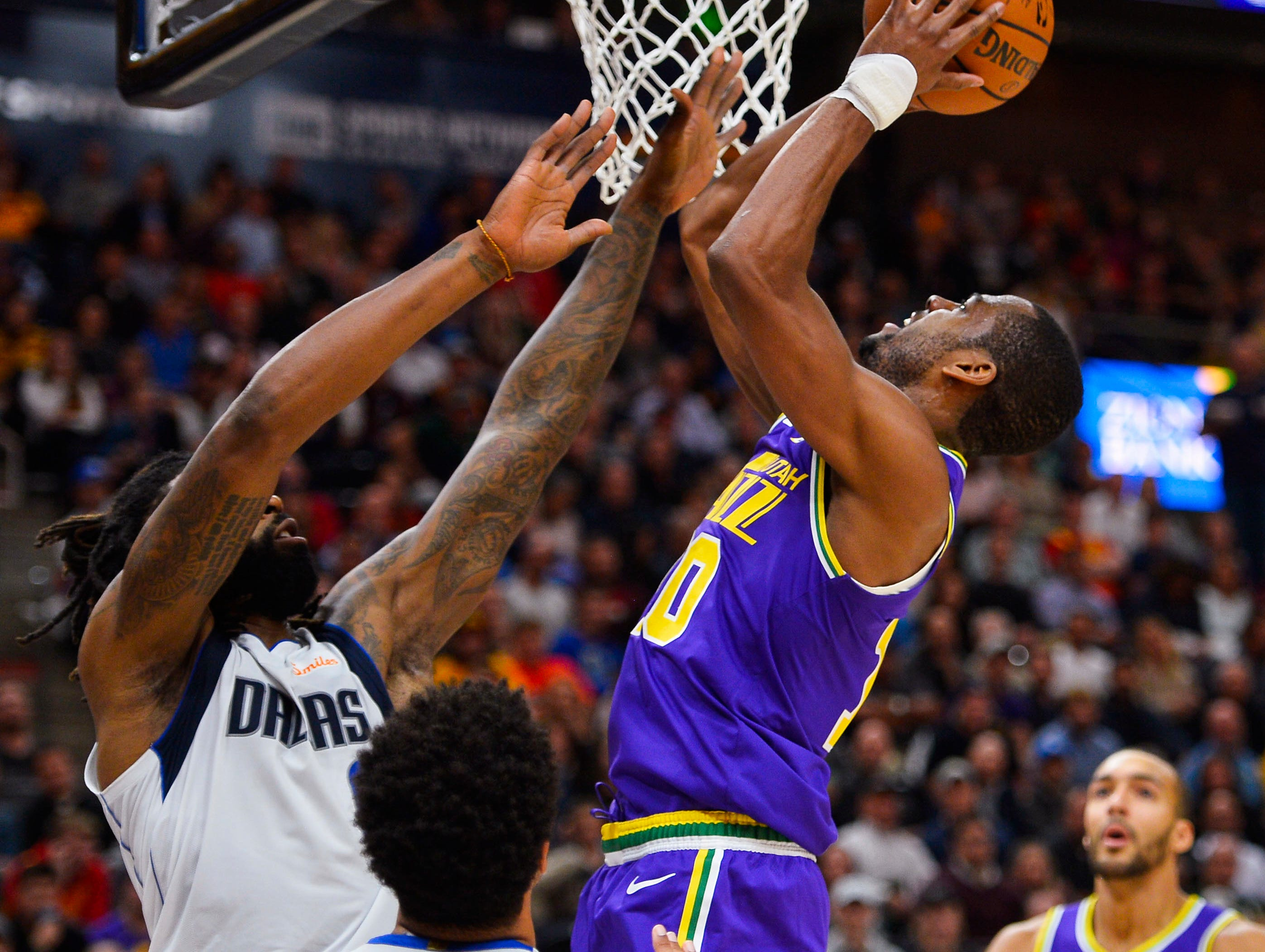 Utah Jazz guard Alec Burks (10) shoots over Dallas Mavericks center DeAndre Jordan, left, during the first half of an NBA basketball game Wednesday, Nov. 7, 2018, in Salt Lake City. (AP Photo/Alex Goodlett)