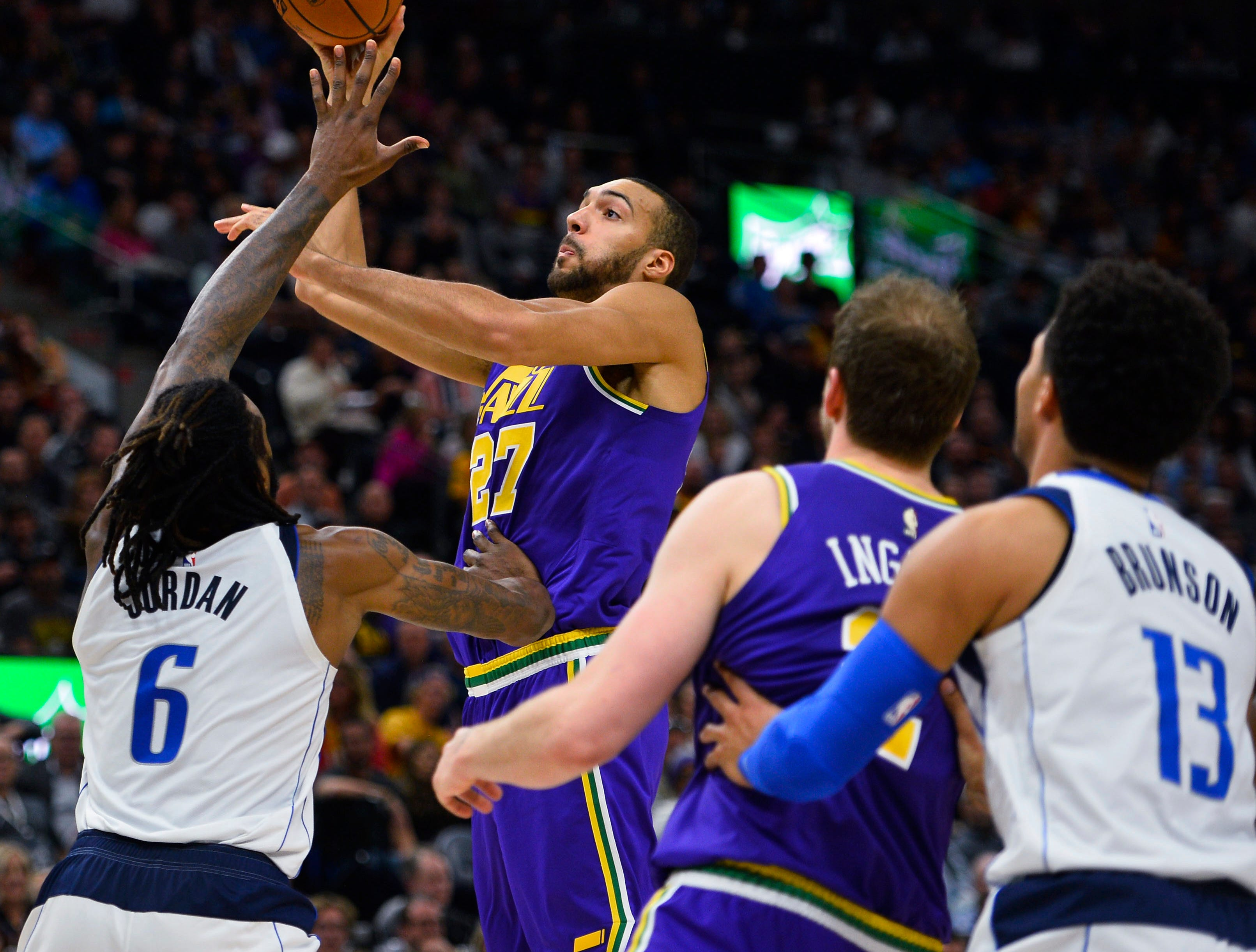 Utah Jazz center Rudy Gobert (27) shoots over Dallas Mavericks center DeAndre Jordan (6) during the first half of an NBA basketball game Wednesday, Nov. 7, 2018, in Salt Lake City. (AP Photo/Alex Goodlett)