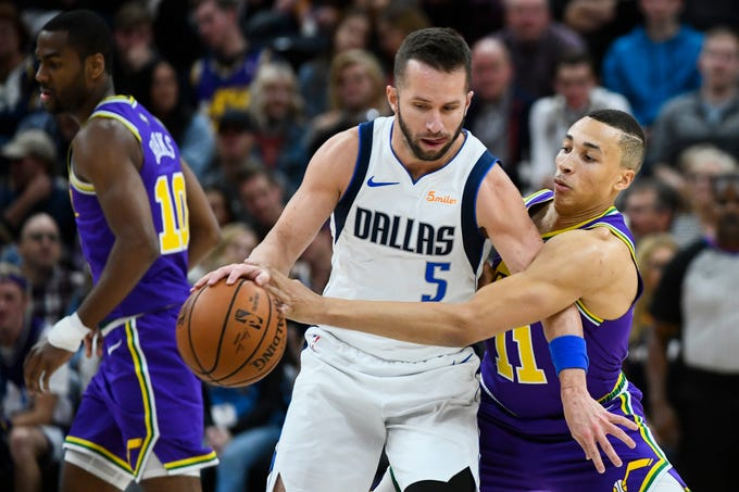 Utah Jazz guard Dante Exum (11) guards Dallas Mavericks guard J.J. Barea (5) during the first half of an NBA basketball game Wednesday, Nov. 7, 2018, in Salt Lake City. (AP Photo/Alex Goodlett)