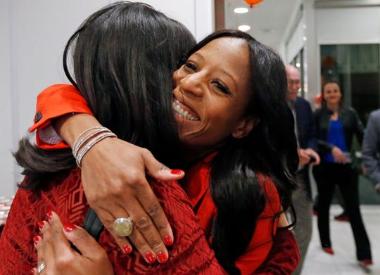 Republican U.S. Rep. Mia Love receives a hug as she greets supporters during an election night party, Tuesday Nov. 6, 2018, in Lehi, Utah. Love is expected to face a stiff challenge from Democrat Ben McAdams in the state's 4th Congressional District. (AP Photo/Rick Bowmer)