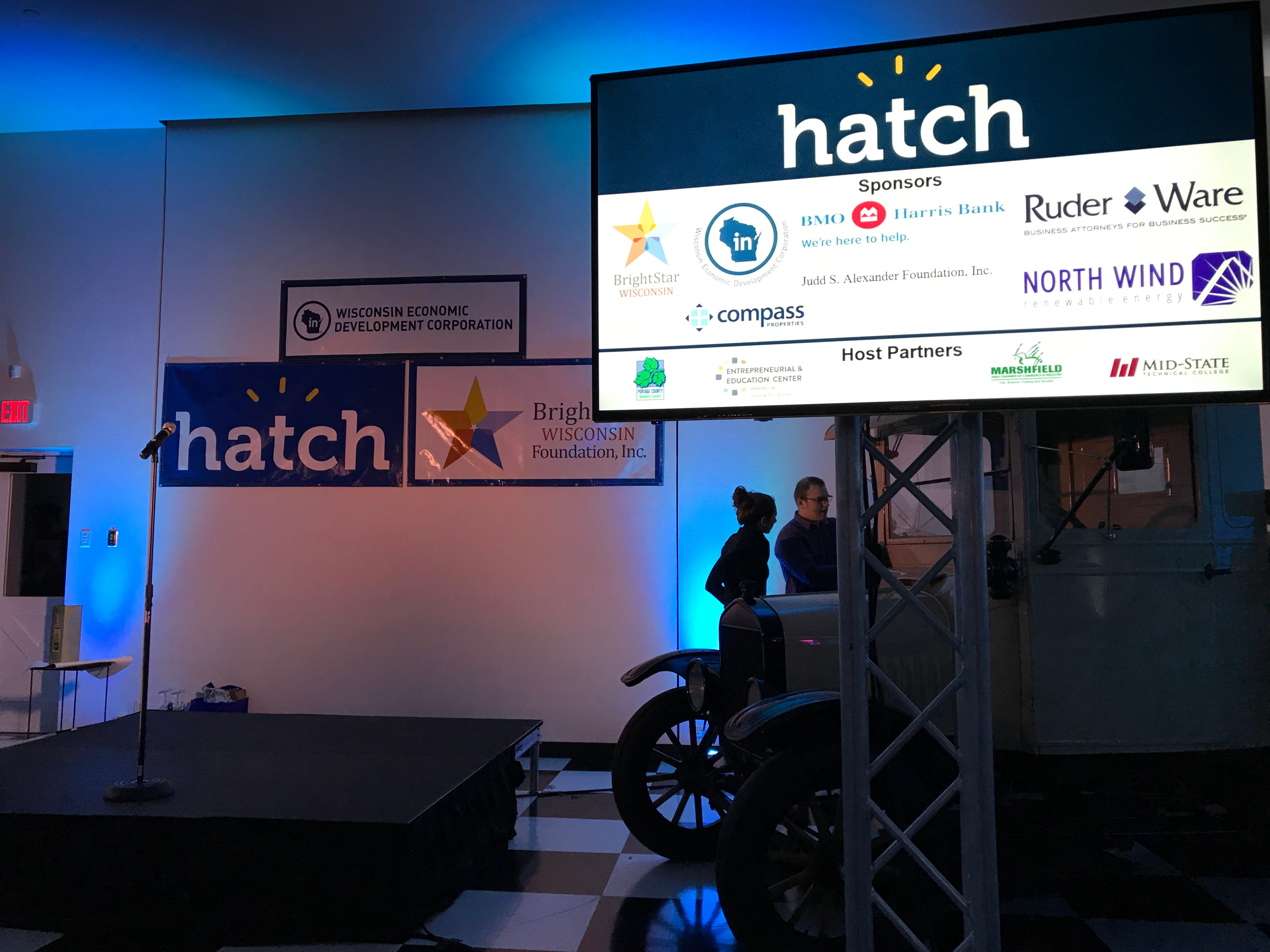 Six entrepreneurs prepared to present on the stage at the Hatch finale in central Wisconsin.
