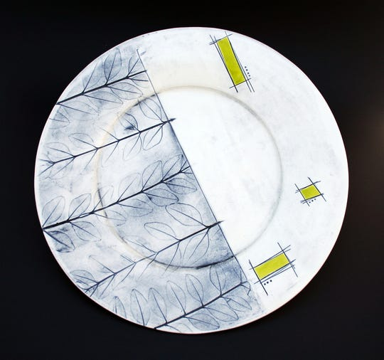 A plate by Dorrie Sanders-Duarte features leaf pattern. She is the proprietor of Myakka Clayworks, which she began out of her garage a few years ago.