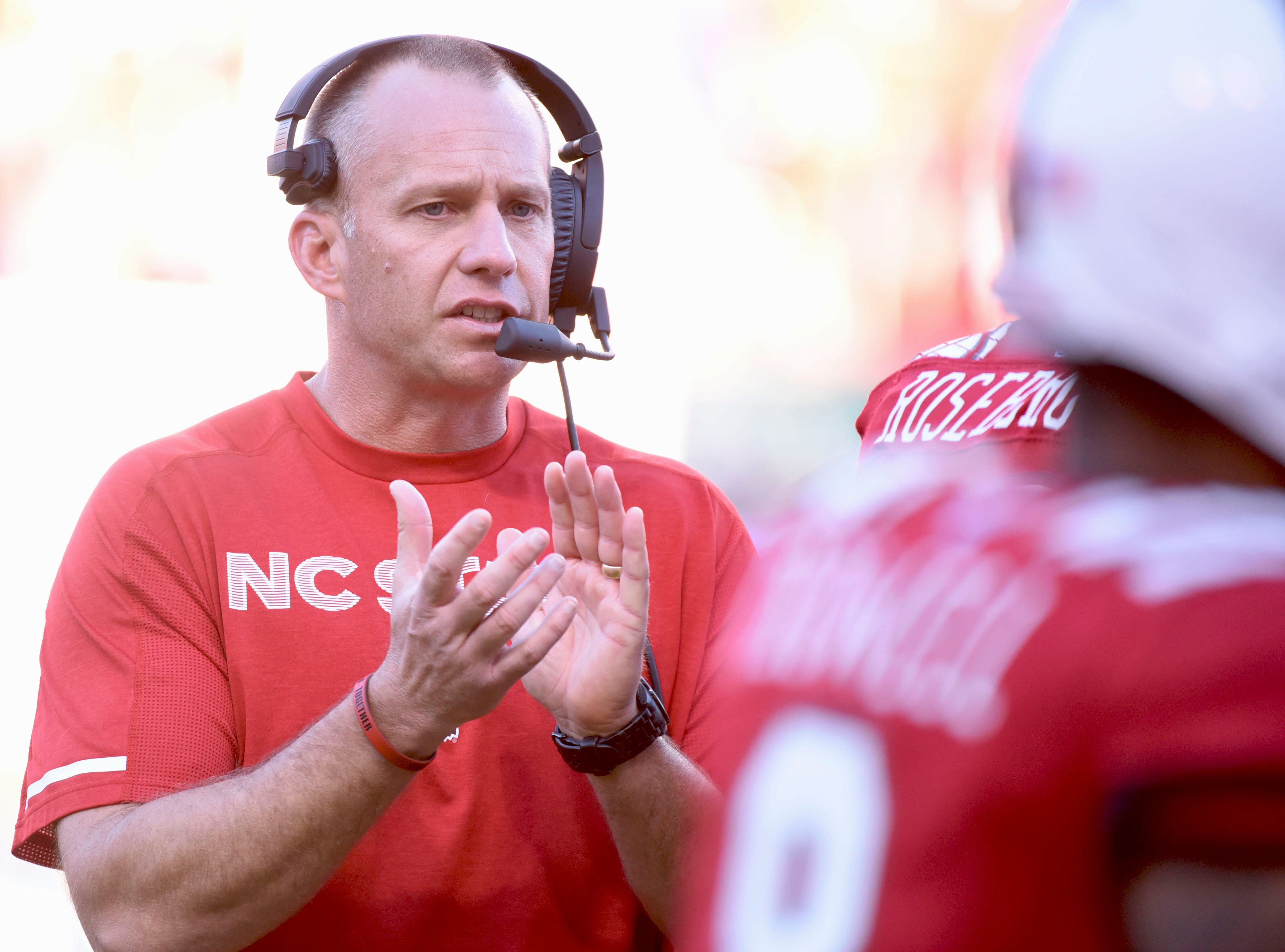 Nov 3, 2018; Raleigh, NC, USA; North Carolina State Wolfpack head coach Dave Doeren encourages his team during the first half against the Florida State Seminoles at Carter-Finley Stadium. Mandatory Credit: Rob Kinnan-USA TODAY Sports