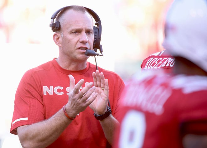N.C. State coach Dave Doeren got his football team back on the practice field Monday for the first time in a week due to COVID-19 outbreak.