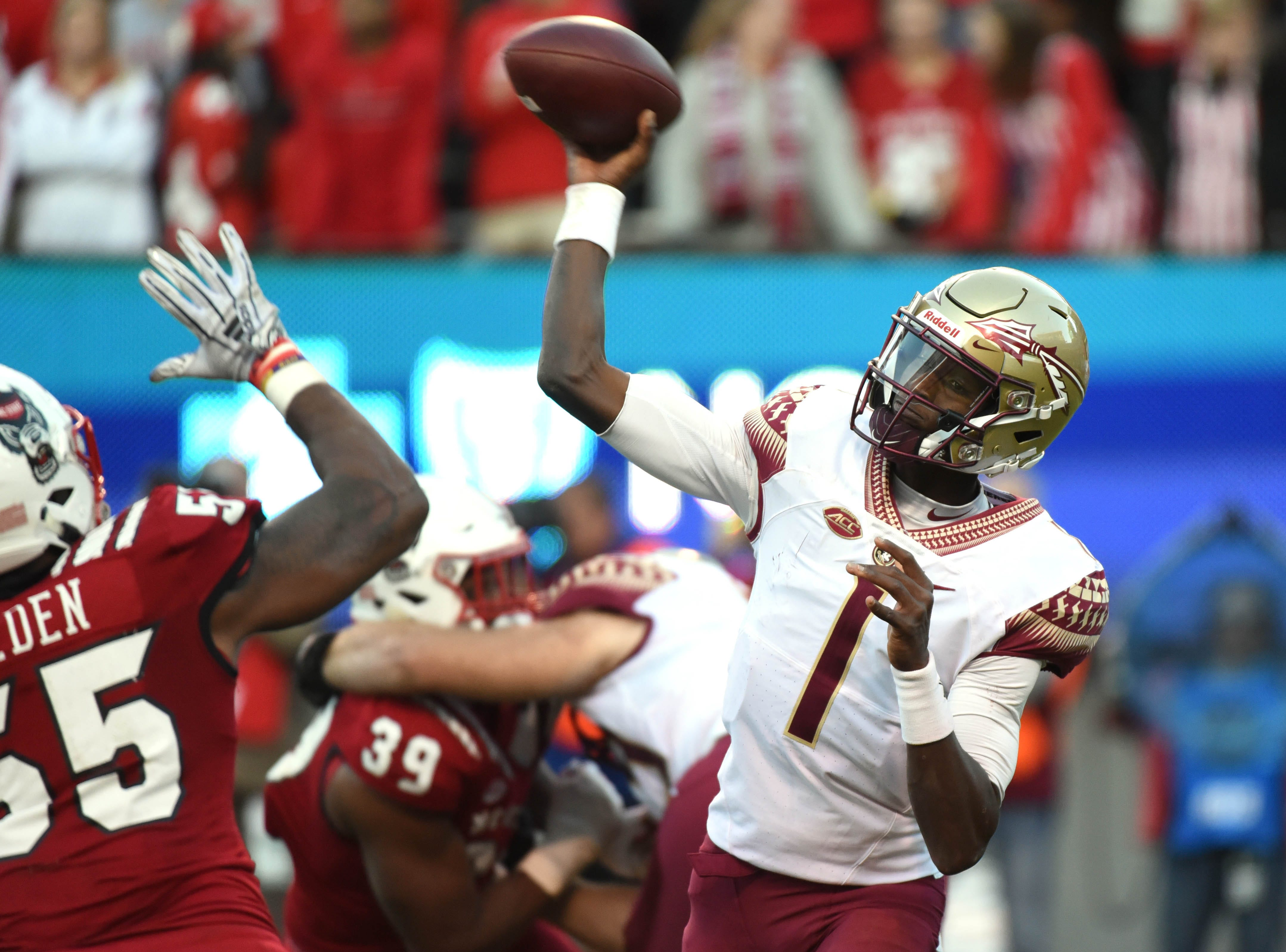 Nov 3, 2018; Raleigh, NC, USA; Florida State Seminoles quarterback james Blackman (1) throws a pass during the second half against the North Carolina State Wolfpack at Carter-Finley Stadium.  The Wolfpack won 47-28.  Mandatory Credit: Rob Kinnan-USA TODAY Sports