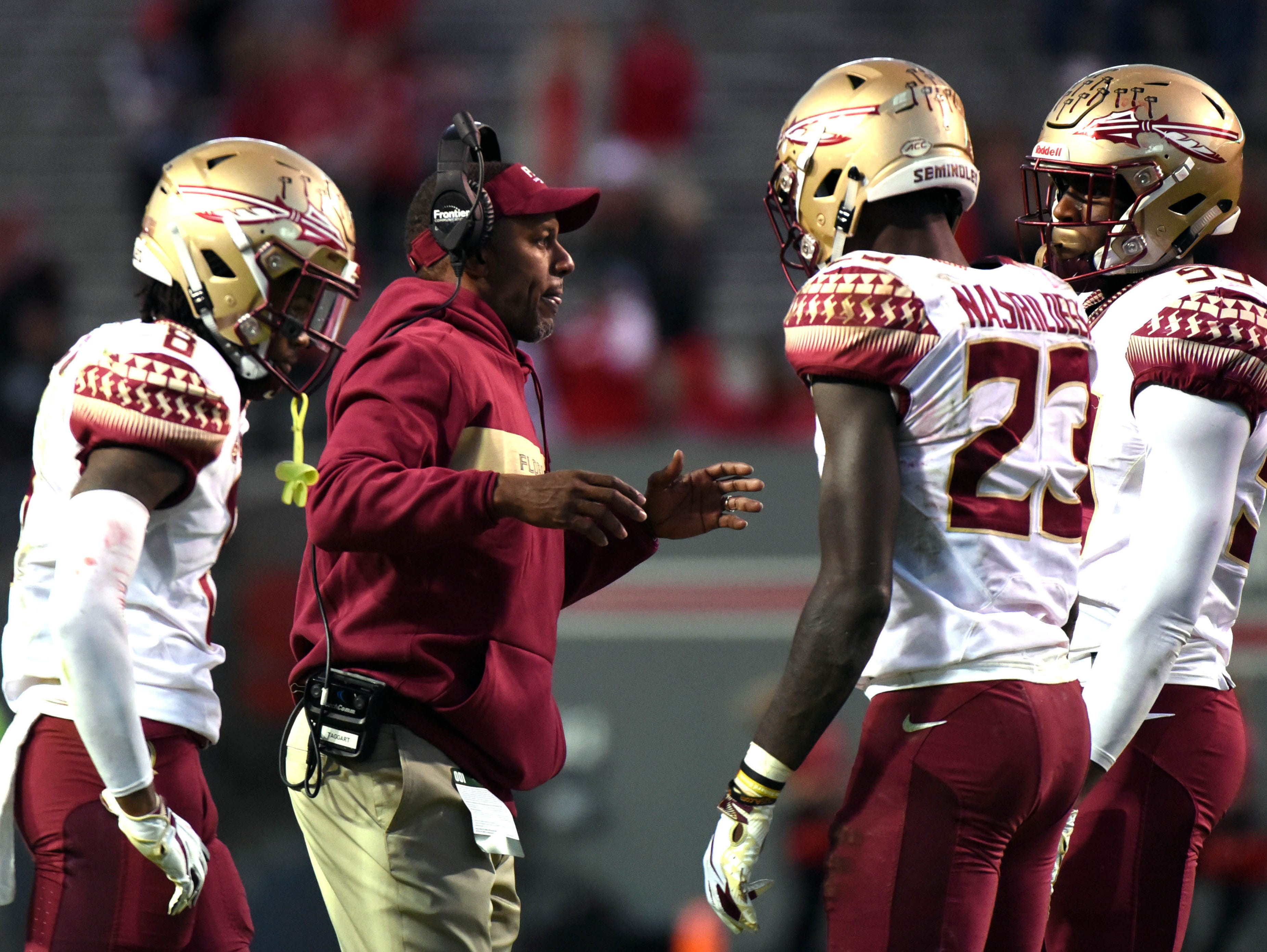 Nov 3, 2018; Raleigh, NC, USA; Florida State Seminoles head coach Willie Taggart (center) talks to his players during the second half against the North Carolina State Wolfpack at Carter-Finley Stadium.  The Wolfpack won 47-28.  Mandatory Credit: Rob Kinnan-USA TODAY Sports