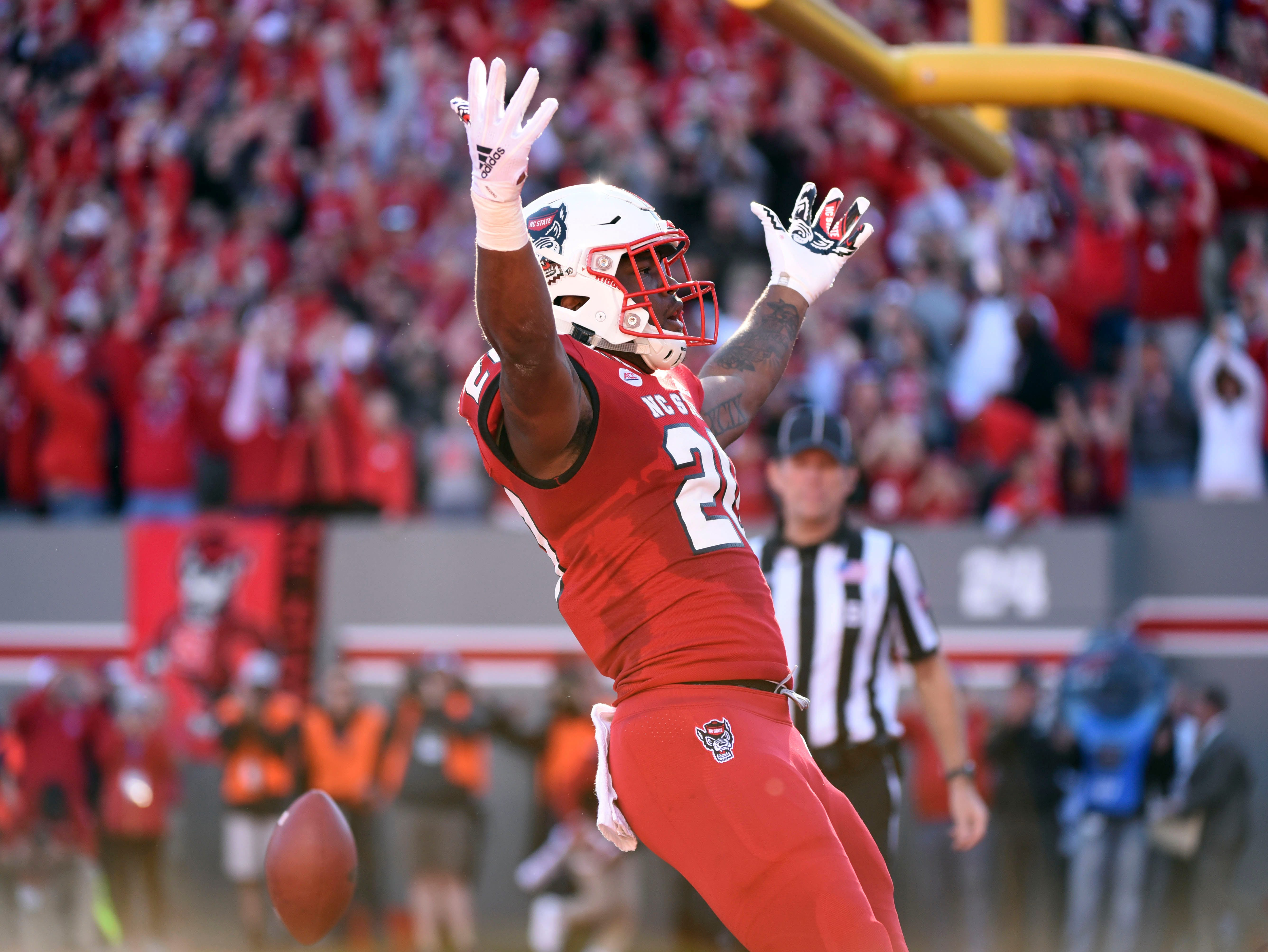 Nov 3, 2018; Raleigh, NC, USA; North Carolina State Wolfpack running back Ricky Person Jr. (20) celebrates a touchdown during the first half against the Florida State Seminoles at Carter-Finley Stadium. Mandatory Credit: Rob Kinnan-USA TODAY Sports