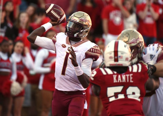 Nov 3, 2018; Raleigh, NC, USA; Florida State Seminoles quarterback James Blackman (1) throws a pass during the first half against the North Carolina State Wolfpack at Carter-Finley Stadium. Mandatory Credit: Rob Kinnan-USA TODAY Sports