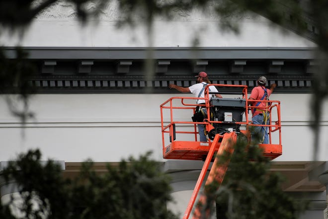 Kraig Goodman, left and Clif Laird, employees of Kelly Sheet Metal, check the integrity of each piece of decorative trim around the front of the Historic Capitol Thursday, Nov. 8, 2018, after pieces of it were damaged during Hurricane Michael last month. Kelly Sheet Metal has been contracted to repair the damages before the governor's inauguration ceremony in January. Due to the age of the building, parts required for the repair need to be custom manufactured.