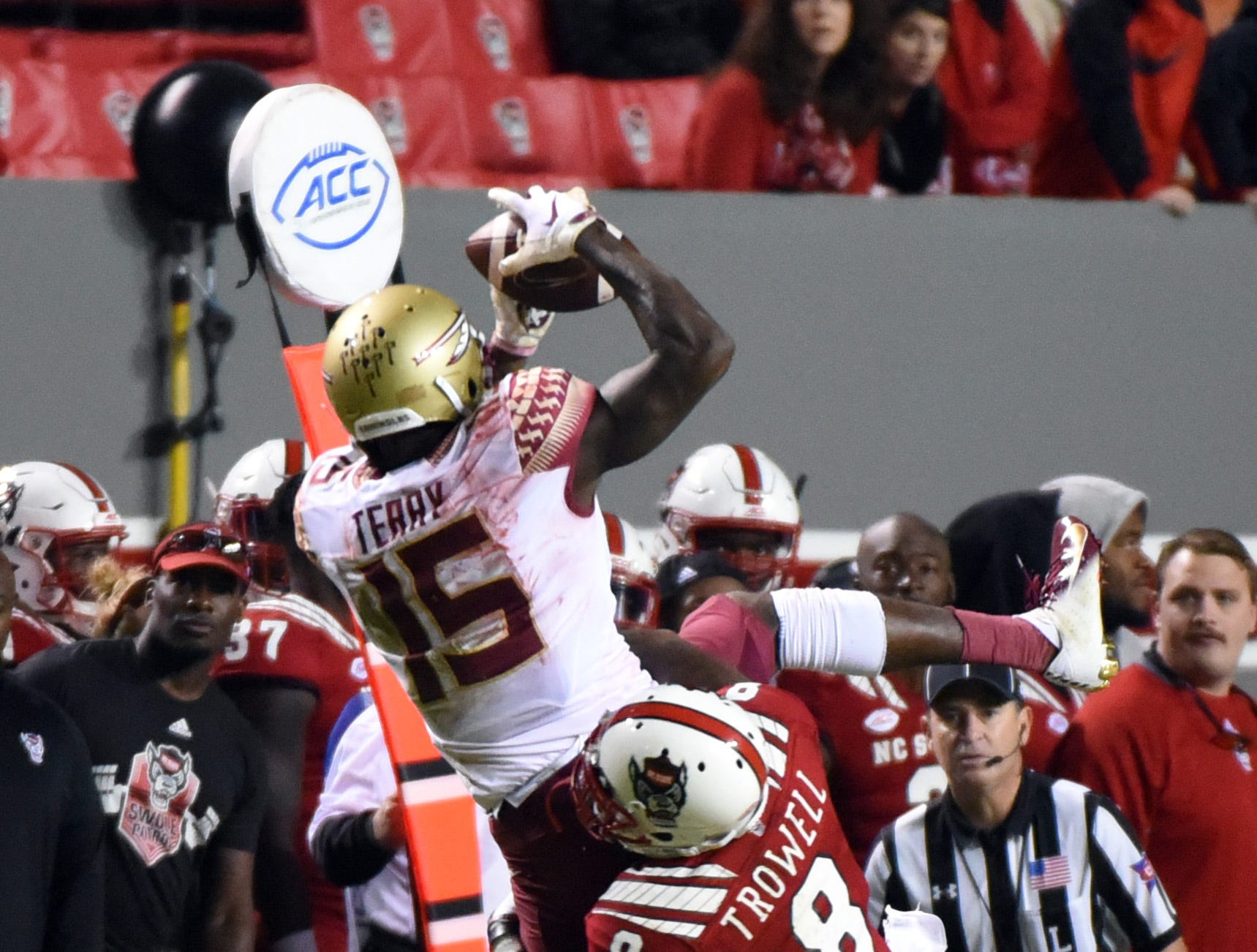 Nov 3, 2018; Raleigh, NC, USA; Florida State Seminoles wide receiver Tamorrion Terry (15) catches a ball over North Carolina State Wolfpack defensive back Maurice Trowell (8) during the second half at Carter-Finley Stadium.  The Wolfpack won 47-28.  Mandatory Credit: Rob Kinnan-USA TODAY Sports