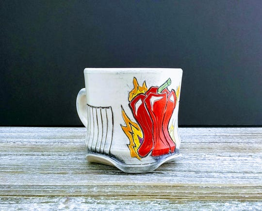 Dorrie Sanders-Duarte has a vegetable- inspired themed in many of her mugs.