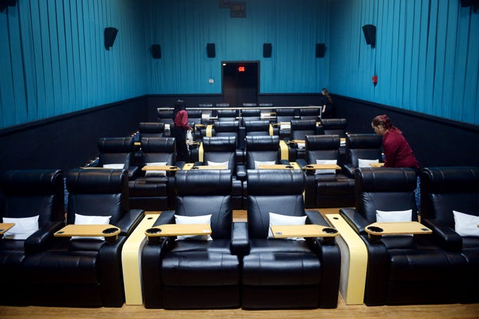 Employees Nadine Laurent (left), Melanie Smith (back) and Lacey Reed walk through and clean one of six theaters Tuesday, Oct. 9, 2018 at Touchstar Cinemas Sabal Palms Luxury 6 in Fort Pierce. The theater boasts large reclining chairs, a full-service bar and several food options other than popcorn that is delivered to you by staff. The theater is the nest to open on the Treasure Coast which opened it's doors in August 2017.