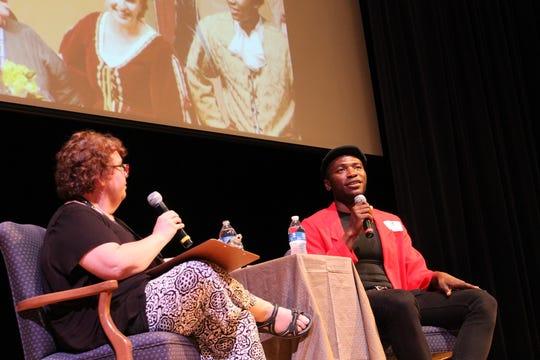 Maggie Baker interviews Jamari Johnson Williams at a Saint Edward's assembly.