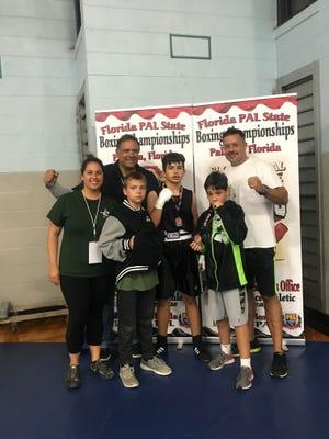 Attending the Florida PAL boxing championships were, from left, Lauren Betsinger, John Perez, Blaine Dameron, David Bass, Jake DelValle, and Noel DelValle.