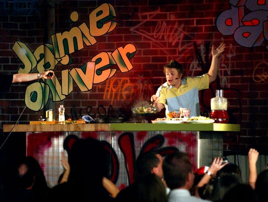"""To accommodate for the size of the crowd and his cooking show, Jamie Oliver, known as """"The Naked Chef,"""" his visit to Vero Beach was moved to the the Vero Beach Community Center Oct. 29, 2002, for hundreds of guests to see the celebrity gourmet cook."""