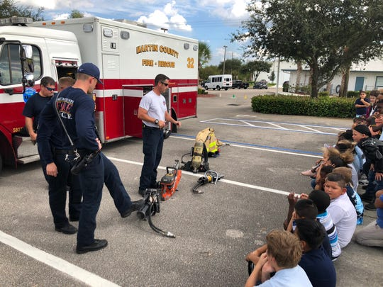 As a part of Fire Education Day, members of the Martin County Fire-Rescue (Station 32) teach children at Boys & Girls Club of Hobe Sound about Engine 32..