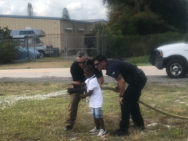 This boy learned how to use a fire hose during Fire Education Day at Boys & Girls Club of Hobe Sound.