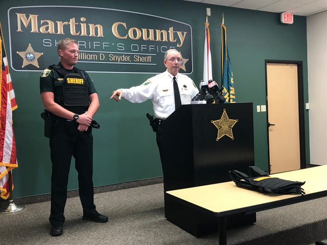 Deputy Justin Seigler (left) and Martin County Sheriff William Snyder talking about the new body armor all deputies will be equipped with starting Wednesday. Deputies said the new armor weighs about 18 pounds.