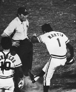 Texas Ranger manager Billy Martin kicks dirt on the feet and pants of home plate umpire Terry Cooney in third inning of game  June 1, 1975, at Arlington Stadium, Texas. Martin was protesting a call at home plate. Is gloating or complaining like this after an election setting a good example for our children and neighbors?