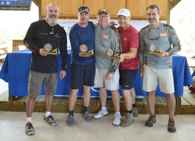 First Place Team Winner - Martin Health Foundation. From left, George McLain, Dr. Don Wood, Dr. Steve Parr, and Richard Rhatigan